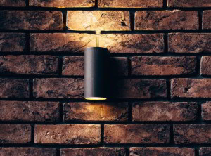 sconce on brick wall